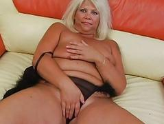 Tanned blonde with hefty..